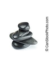 big black spa stones isolated on white