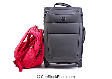 Big black suitcase and red backpack isolated on white background