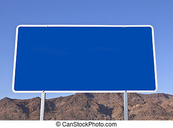 Big blank blue road sign with desert mountain background.