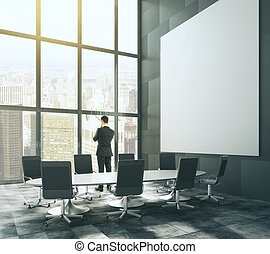 Big blank white picture in loft conference room