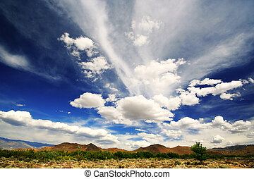 A beautiful blue sky with dramatic clouds in the sierra foothills of Bishop, California.