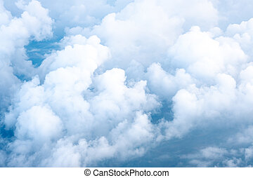 Big Blue sky and Cloud Top view from airplane window,Nature background.