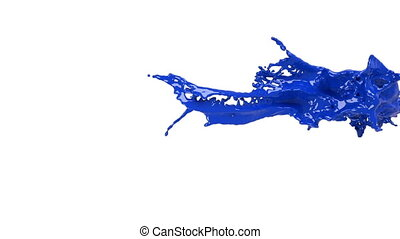 big blue splashes in slow motion. Colored paint