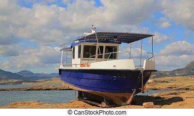 Big Boat Standing On The Seashore
