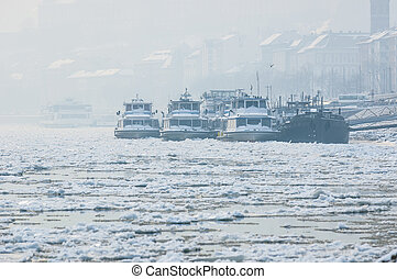 Big boats stuck in the ice at winter