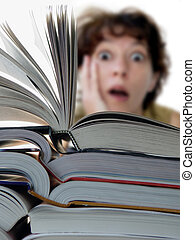 Big books - Terrified woman behind a big pile of books