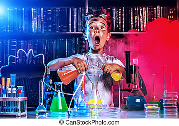 big boom - A boy doing experiments in the laboratory. ...