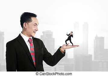 Big boss holding small subordinate