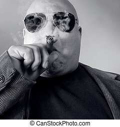 The big Boss, Head Honcho, Top Dog... An image of the Man in charge, smoking a cigar.