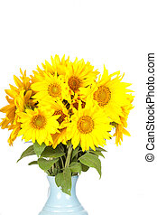 Big bouquet of sunflowers in a jug on a white background