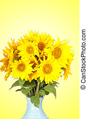 Big bouquet of sunflowers in a jug on a yellow background