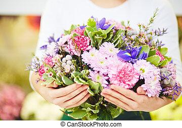 Big bouquet - Florist holding big bouquet of fresh flowers