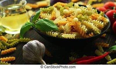 Big bowl of macaroni and vegetables - Big black bowl full of...
