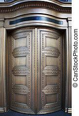 Big Brass Revolving Bank Doors up close