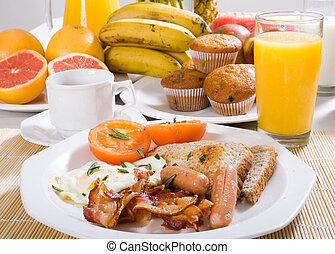 a large selection of fruit and fried foods for breakfast