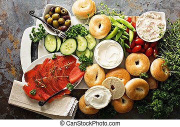 Big breakfast platter with bagels, smoked salmon and...