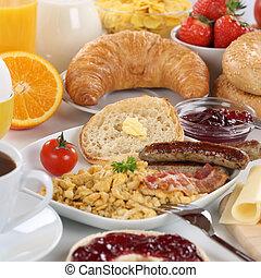 Big breakfast with orange juice, cheese, fruits and scrambled eg