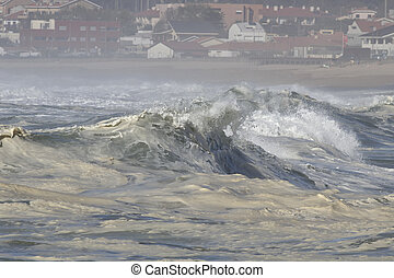 Big breaking waves approching the coast