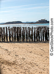 Big breakwater and beach in Saint Malo, 3000 trunks to defend the city from the tides, Ille-et-Vilaine, Brittany, France