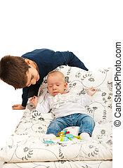 Big brother caring his sleepy sister