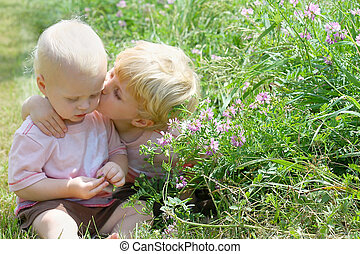 Big Brother Kisses Baby - A big Brother gives his baby...