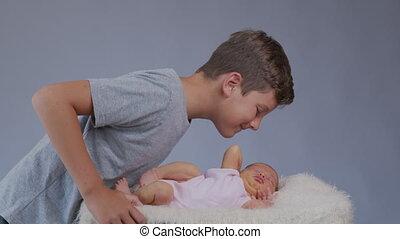 Big brother kisses newborn sister. - Big brother kisses ...