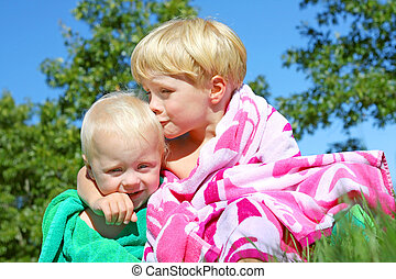Big Brother Kissing Baby in Beach Towels