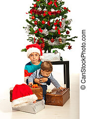 Big brother with boy and Christmas gifts - Big brother...