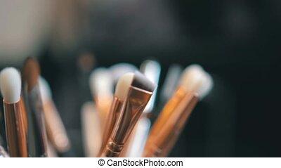 Big brush set for make-up lying on the table