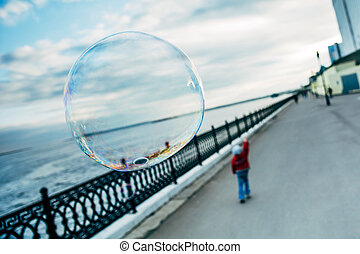 big bubble against a background of a little girl