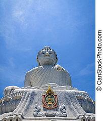 Big Buddha on blue sky background.