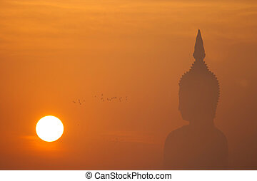 Big buddha statue at sunset