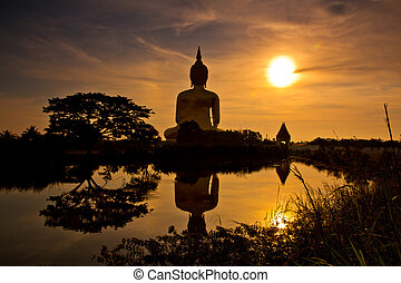 Big buddha statue in sunset  thailand