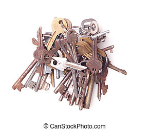 Big bunch of old keys isolated on white