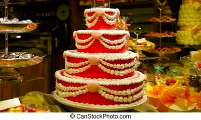 big cake in shop vitrine