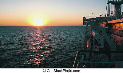 Big Cargo Ferry and Sunset on the Sea