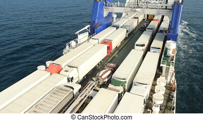 big cargo ferry - sea ferry transports trucks