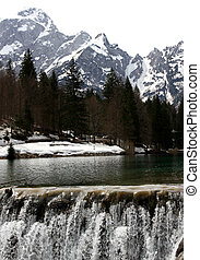 cascade of water in the Lake with the mountains - big...
