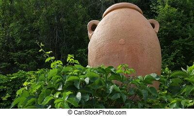 Big ceramic jug in botanical garden