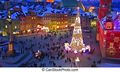 Big Christmas tree sparkling at Castle Square in Warsaw, Poland