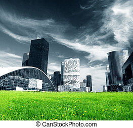 Big city and green fresh meadow - Big city skyscrapers and...
