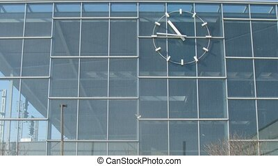 Big clock hangs on outsides of railway station