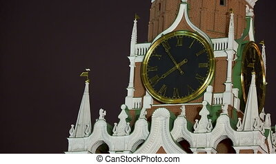 Big clock on the Spasskaya tower in Kremlin. Historic landmark in Moscow, Russia.