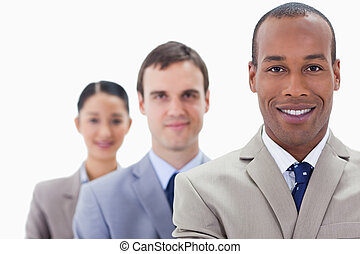 Big close-up of people dressed in suits smiling in a single...