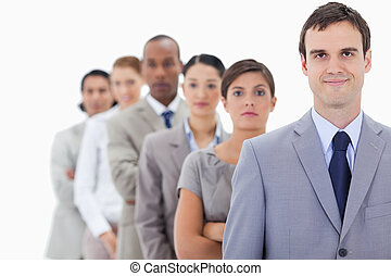 Big close-up of serious colleagues in a single line looking...