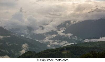 Big clouds over mountain peaks,Caucasus. timelapse 4K