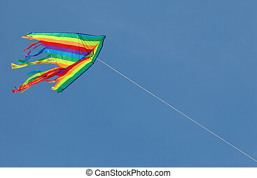 kite flying high in the sky symbol of freedom and joy