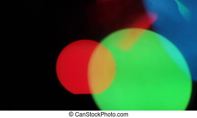 Big colorful bokeh lights on black