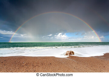 big colorful rainbow over ocean