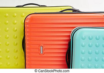 Big colorful suitcases macro.